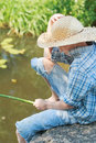 Teenager angler with wooden rustic fishing rod on Royalty Free Stock Photo