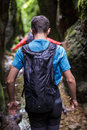 Teenager with backpack on a canyon Royalty Free Stock Photo