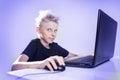 Teenager behind a computer Royalty Free Stock Photo