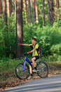 Teenager on a bicycle traveling in the woods Stock Image