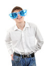 Teenager in big blue glasses isolated on the white background Royalty Free Stock Photos