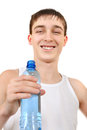 Teenager with bottle of water happy on the white background Royalty Free Stock Photography