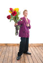 Teenager with bouquet cheerful a of flowers Royalty Free Stock Image