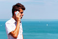 Teenager boy calling by cellular phone at lake balaton hungary Stock Photos