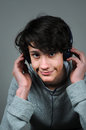 Teenager boy with earphones listening music Royalty Free Stock Image