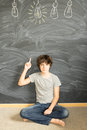 Teenager boy getting an idea Royalty Free Stock Photo