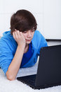 Teenager boy with laptop Stock Photography