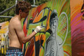 Teenager boy painting a graffiti moscow russia july unidentified during sports festival in luzhniki Royalty Free Stock Photo