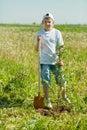 Teenager boy   planting tree Royalty Free Stock Photo