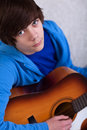 Teenager boy playing the guitar Royalty Free Stock Photography