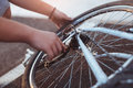 Teenager boy repair tire on bicycle, close up Royalty Free Stock Photo