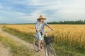 Teenager boy riding a bicycle on country road Royalty Free Stock Photo