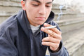 Teenager boy smoking cigarette outdoor. Concept of young people w Royalty Free Stock Photo