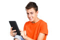 Teenager boy touching a tablet pc over white Stock Photos