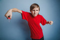 Teenager boy twelve years in the red t-shirt with Royalty Free Stock Photo