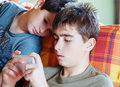 Teenager boys playing on smartphone outdoor with shallow focus Stock Photo