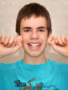 Teenager brushing his teeth with dental floss Royalty Free Stock Photo