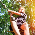 Teenager bungee jumping toned photo of kid jump in the summer forest Stock Photo