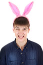 Teenager with bunny ears angry isolated on the white background Royalty Free Stock Photo
