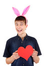 Teenager with bunny ears and heart funny red shape on the white background Royalty Free Stock Image