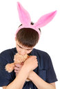 Teenager with bunny ears infantile and teddy bear isolated on the white background Royalty Free Stock Photo