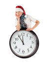 Teenager in cap of Santa Claus and large clock Stock Photos