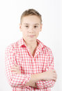 Teenager caucasian standing in checkered shirt white background Royalty Free Stock Photography