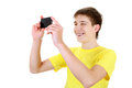 Teenager with cellphone take a picture a on the white background Stock Photos