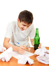 Teenager compose a letter cheerful with beer on the white background Royalty Free Stock Image