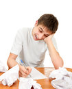 Teenager compose a letter cheerful young man on the white background Royalty Free Stock Photo