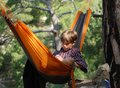 Teenager crimea trekking relax in a hammock reading an e book Royalty Free Stock Photo