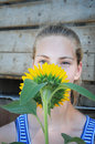 Teenager cute girl with sunflower Royalty Free Stock Photos
