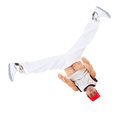 Teenager dancing breakdance ain action break dance over white Royalty Free Stock Image