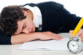 Teenager dozing off while writing his test Royalty Free Stock Photos
