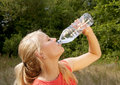 Teenager drinking water pretty young blond woman Stock Photography