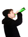 Teenager drinks a beer on the white background Stock Images