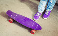 Teenager feet in jeans and snickers with skateboard photo retro tonal correction instagram old style Stock Image