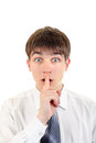 Teenager with finger on his lips in silence gesture isolated the white background Royalty Free Stock Photography