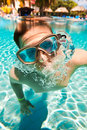 Teenager floats in pool Stock Photography