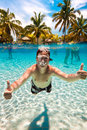 Teenager floats in pool Stock Images