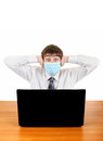Teenager in flu mask with laptop shocked young man at the desk isolated on the white Royalty Free Stock Images