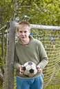 Teenager with a football Stock Images
