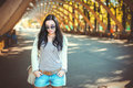 Teenager girl in denim shorts and sunglasses Royalty Free Stock Photo
