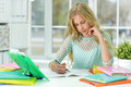 Teenager girl doing homework Royalty Free Stock Photo