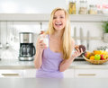 Teenager girl eating chocolate muffin with milk Royalty Free Stock Photo