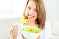Teenager girl eating salad Royalty Free Stock Photo