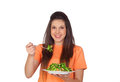 Teenager girl eating vegetables isolated on white background Stock Photo