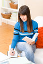 Teenager girl home - student write homework Stock Photo