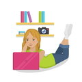 Teenager girl laying in her room with pink laptop Royalty Free Stock Photo