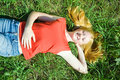 Teenager girl lying in grass Stock Photo
